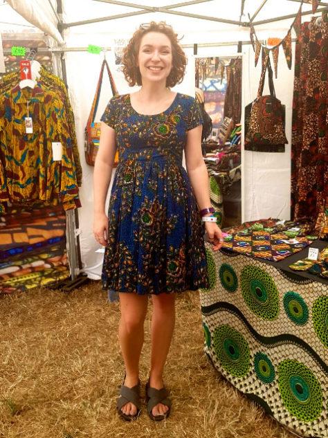 Women's dark blue African print flare dress customer wearing WOMAD Festival UK