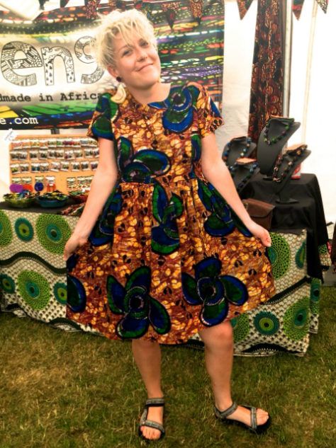 Women's yellow African print flare dress customer wearing Africa Oye Festival in Liverpool UK