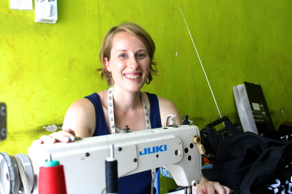 Kitenge founder Sian Wells in the tailors new workshop in Tanzania
