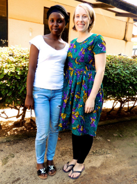 Kitenge Store Fouder Sian standing next to workshop manager and tailor Upendo in Tanzania wearing a teal African print dress