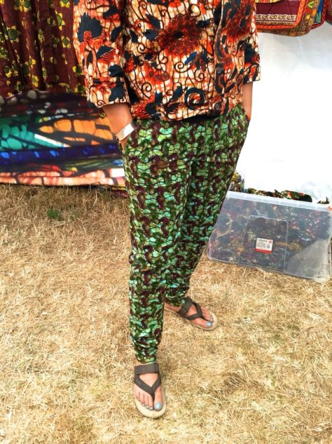 Women's turquoise African print trousers pants customer wearing WOMAD Festival UK