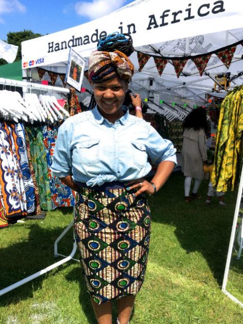 Women's black diamond African print pencil skirt customer modelling at Africa Oye Festival in Liverpool UK