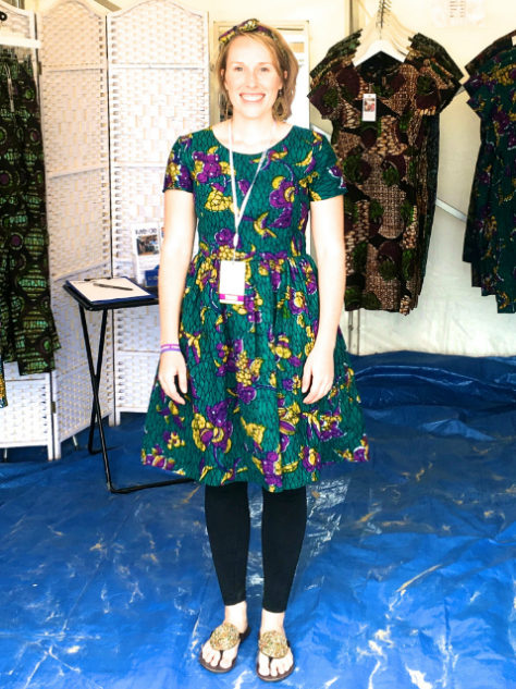Kitenge Store founder Sian wearing teal African print dress fit and flare style at Looe Music Festival on the beach in Cornwall UK
