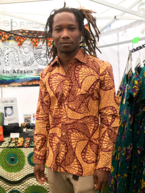 Men's cream African print long sleeve shirt worn by a musician at One Love Festival London UK