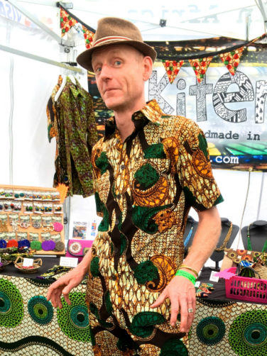 Men's gold African print short sleeve shirt customer wearing Beautiful Days Festival UK