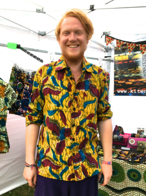 Men's yellow African print long sleeve shirt customer wearing at WOMAD Festival UK