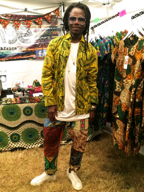 Men's yellow African print long sleeve shirt worn by a Kitenge customer at One Love Festival UK
