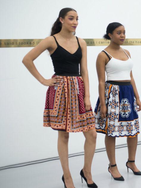 Women's red African print kanga flare skirt modelled at a fashion show in Bristol UK