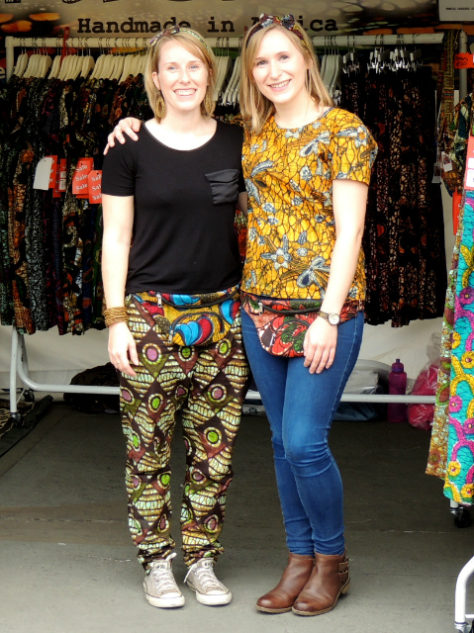 Kitenge Store Founder Sian and her sister wearing African print trousers and top at Africa on The Square in Trafalgar Square London
