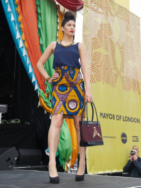 Women's amber African print pencil skirt model wearing fashion show Africa on The Square London UK