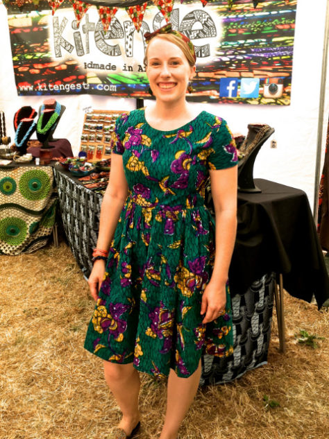 Women's teal African print dress Kitenge founder Sian wearing at WOMAD Festival in Wiltshire UK