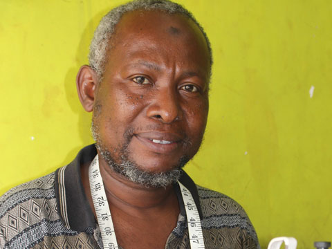 Kitenge african print clothing senior tailor in Tanzania Abdallah