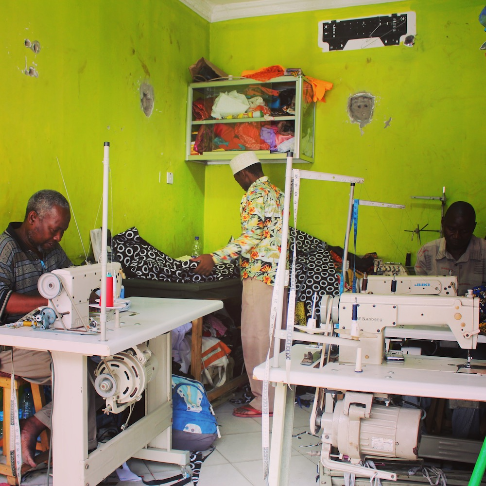 Kitenge tailors working in their brand new workshop in Tanzania East Africa