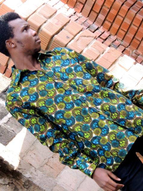 Men's dark green African print long sleeve shirt model wearing outside Tanzania