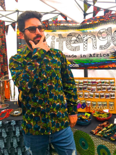 Men's green African style shirt Kitenge customer wearing at Africa Oye festival in Liverpool UK