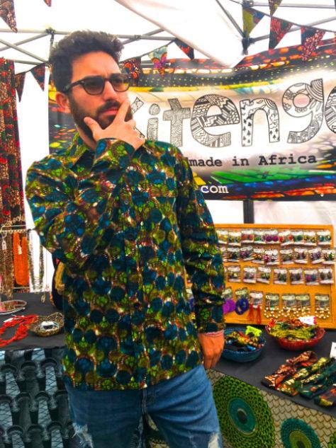 Men's green African style shirt Kitenge customer wearing at Africa Oye festival in Liverpool UK