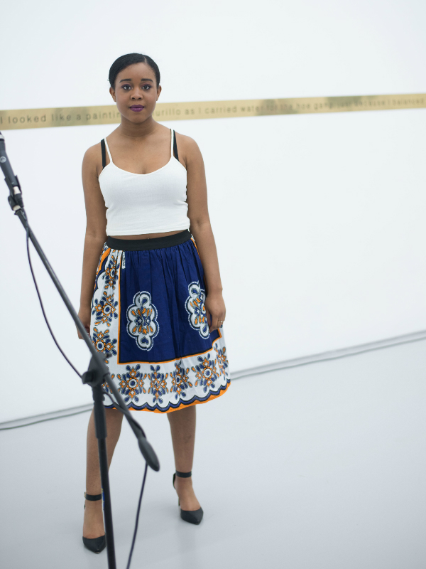 Kitenge model wearing a blue kanga African print flare skirt during a fashion show at the Lubaina Himid exhibition in Bristol UK