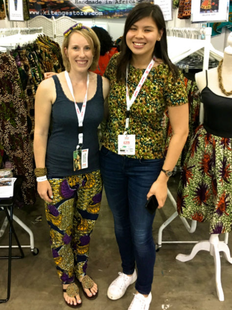 Women's green African print top blouse with short sleeves modelled by a volunteer at Kitenge Store's exhibition stand at Africa Fashion Week London