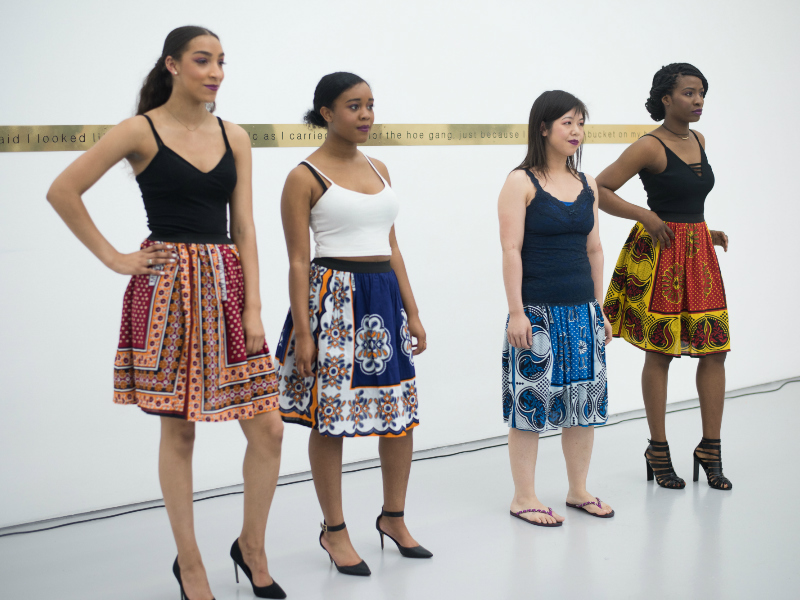 Models wearing African print kanga skirts by Kitenge at the Lubaina Himid exhibition in Bristol UK
