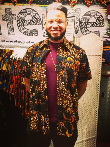 Kitenge amber African print short sleeve shirt customer wearing on our stall at Afropunk London 2017