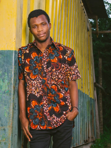 Red Mens African Print Short Sleeve Shirt Model Wearing in Tanzania