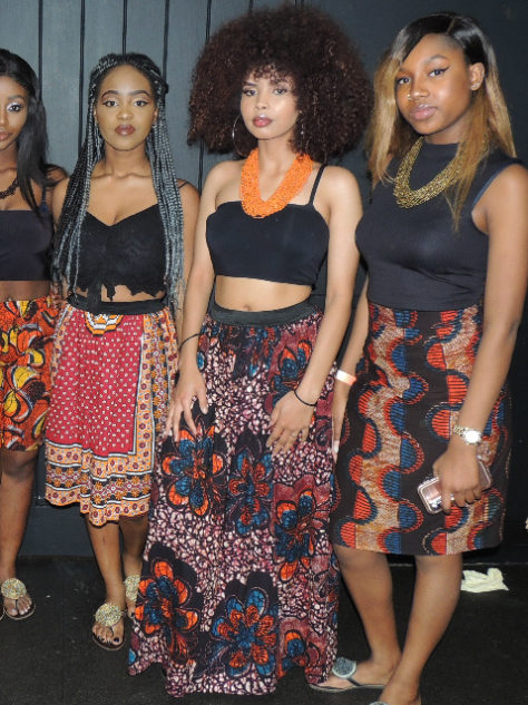 Red African print maxi, pencil and flare skirts worn by a model at Afrofest event UK