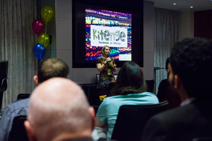 Kitenge founder Sian presenting the fashion show at the School for Social Entrepreneurs Fellowship graduation event at PwC offices in London