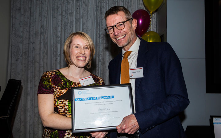 Kitenge Founder Sian collecting her certificate of Fellowship from Alastair Wilson CEO of The School for Social Entrepreneurs at PwC graduation event in London