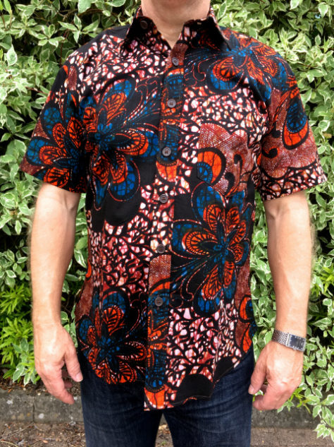 Men's red African print shirt with short sleeve model wearing outside front view