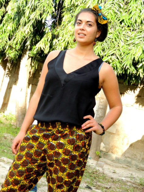 Female model wearing brown African print trousers pants in Tanzania photoshoot