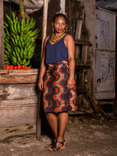 Red African print pencil skirt worn by a model in Tanzania