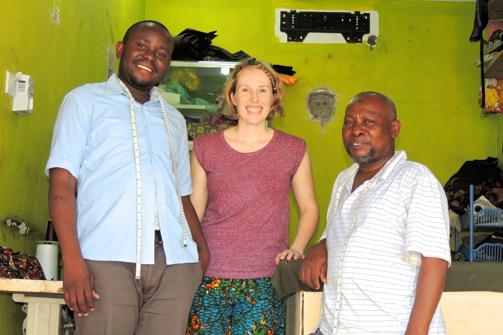 Kitenge founder Sian Wells with tailors at their new workshop in Tanzania
