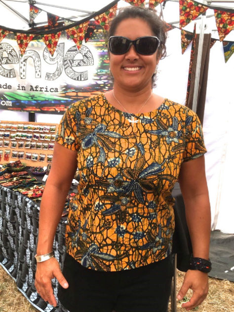 Women's yellow African print top volunteer wearing at WOMAD Festival UK