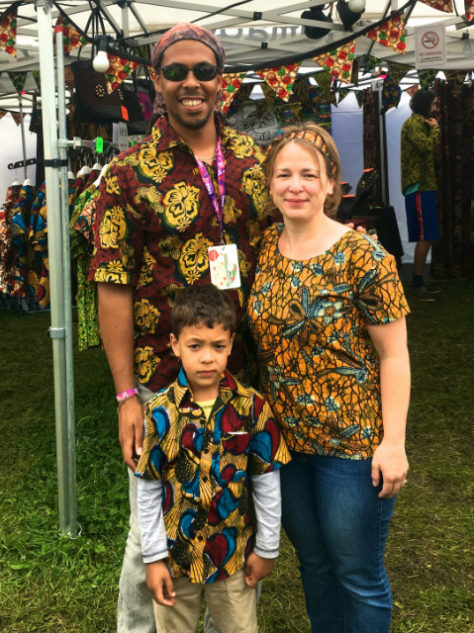 Women's yellow African print top blouse with short sleeve modelled by a customer at WOMAD Festival UK