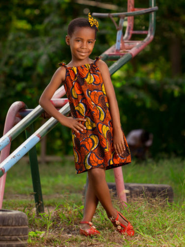 Red Girls African Print Dress with Shoulder Ties Model Wearing