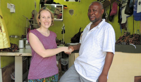 Sian shaking hands with Kitenge's main tailor Abdallah at his new workshop in Tanzania