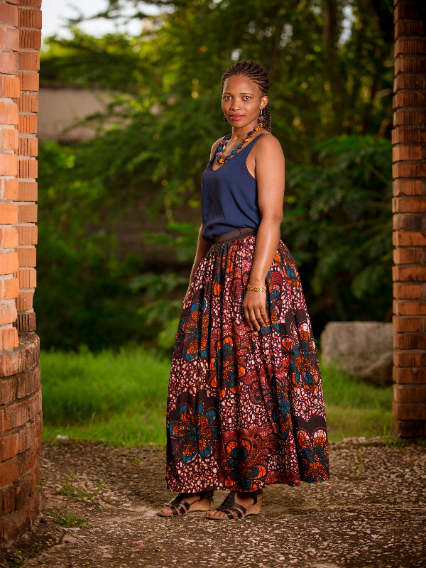 Model wearing red blue African print maxi skirt in Tanzania at a photoshoot