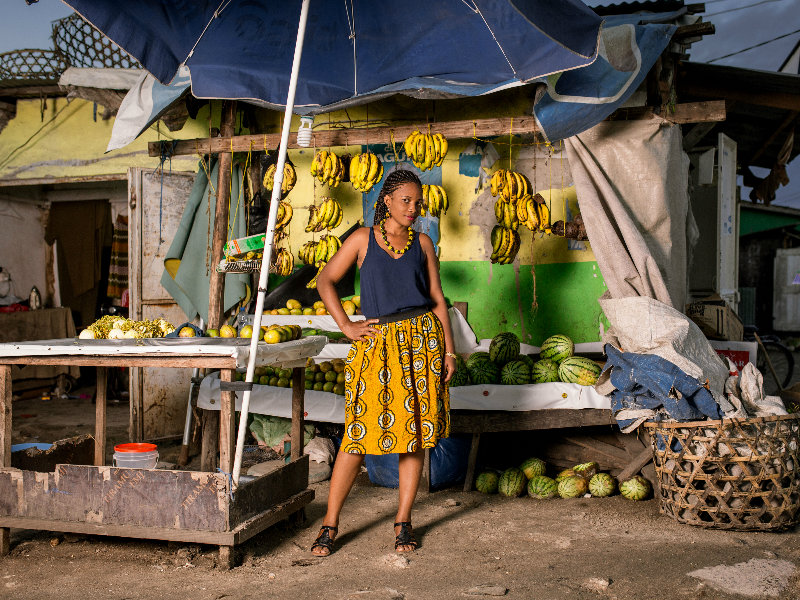 Model wearing yellow african print flare skirt in Tanzania at a photoshoot