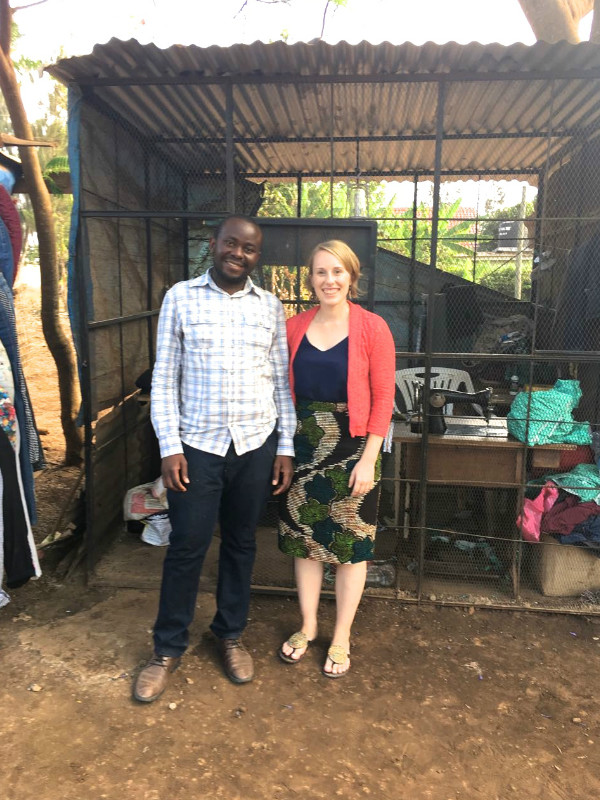Kitenge's newest tailor Hassan with our founder Sian standing outside his own workshop in Arusha, Tanzania which he built himself from scratch