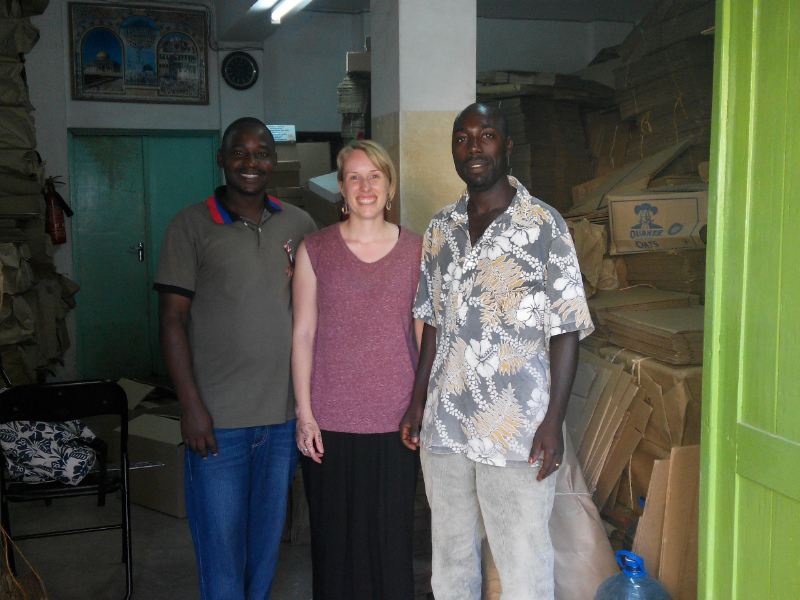 Sian with our supplier of boxes for shipping our African styles at their storage office in Tanzania