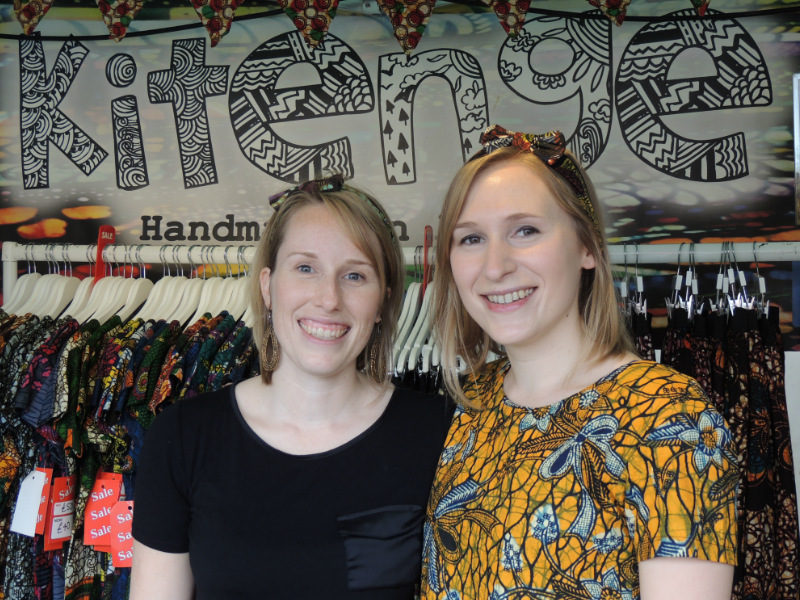 Kitenge Store founder Sian with her sister and volunteer Anna wearing a yellow African print top at Africa on The Square 2017