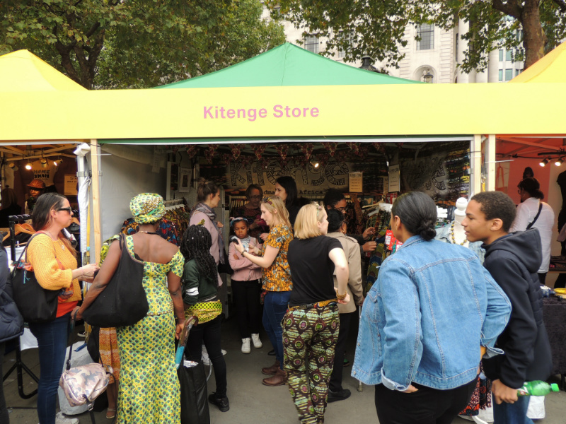 The busy Kitenge Store Stall selling modern african print clothing at Africa on The Square 2017 in Trafalgar Square London