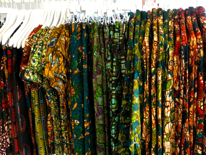 Kitenge Store's African wax print clothing displayed on a clothes rail at a social enterprise Christmas fair at RSA insurance group's offices in Central London