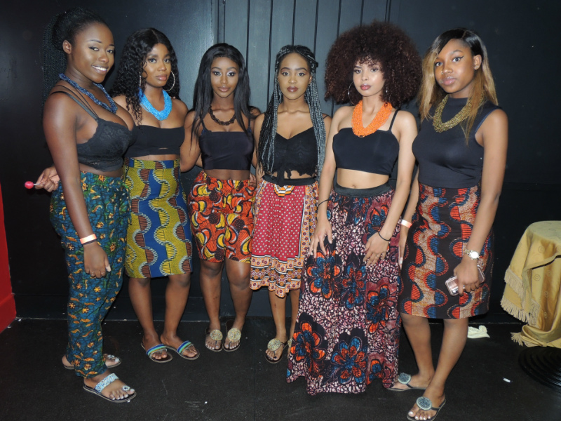 Kitenge Store models from University of Warwick's East African Society at their AFROFEST 2017 event wearing African print trousers and African print skirts