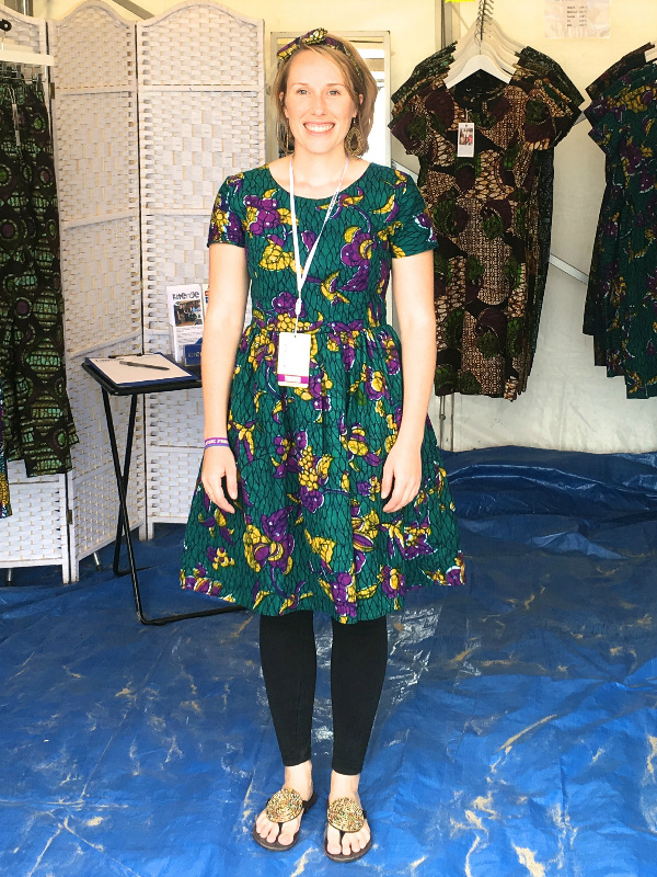 Kitenge founder Sian wearing an African print dress casually with leggings and leather beaded sandals at Looe Music Festival on the beach