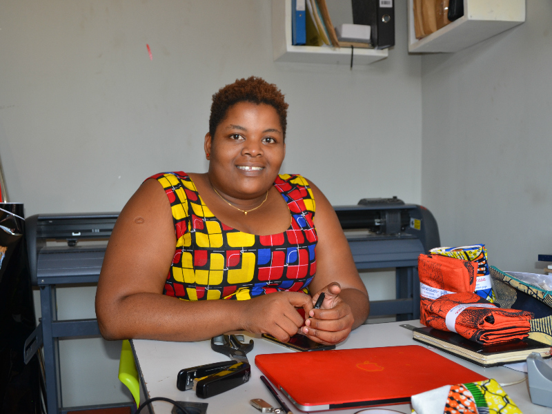 Kitenge tailor Betty in her old office in Tanzania before expanding her business