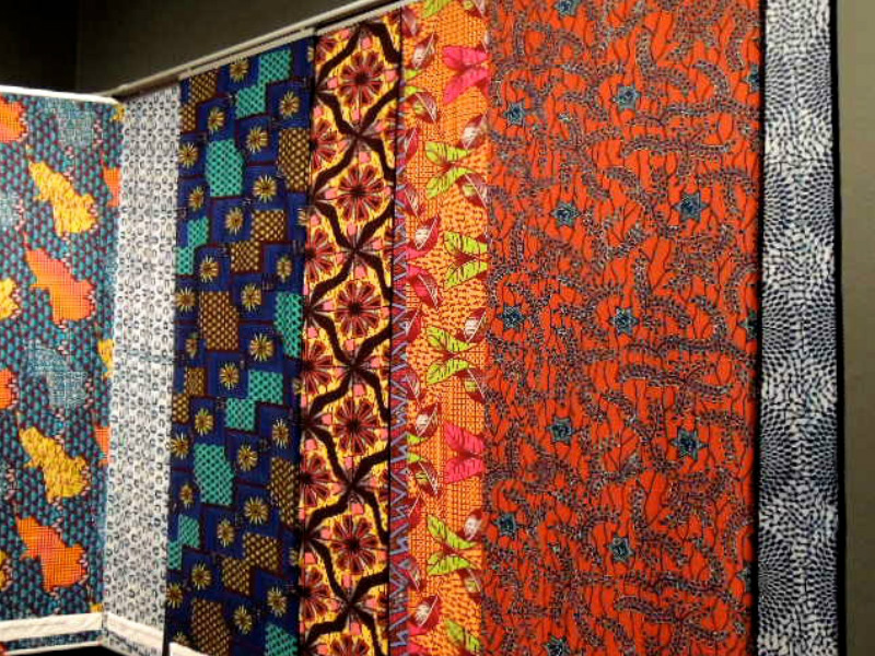 ankara designs printed in Ghana hanging on the wall at the Fashion Cities Africa exhibition at the Brighton Museum in January 2017