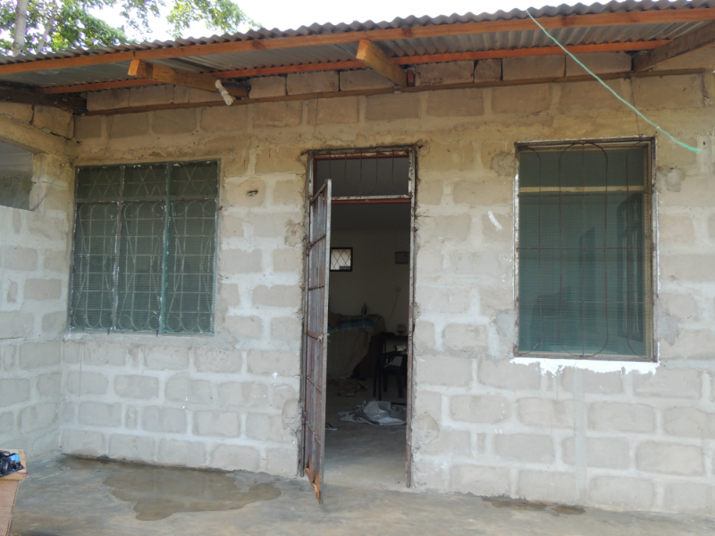 Kitenge tailor Betty's newly built workshop outside front view in Tanzania