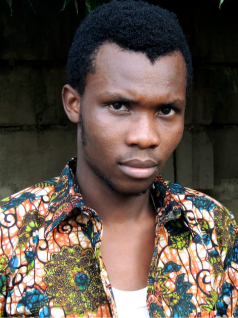 Men's green floral African print shirt model wearing Tanzania close up