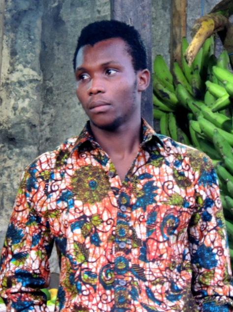 Men's green floral Kitenge African print shirt with side pocket model wearing Tanzania close up